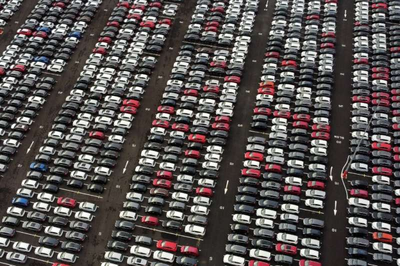 New cars got parked as they awaited for dealerships to reopen following coronavirus-imposed closures