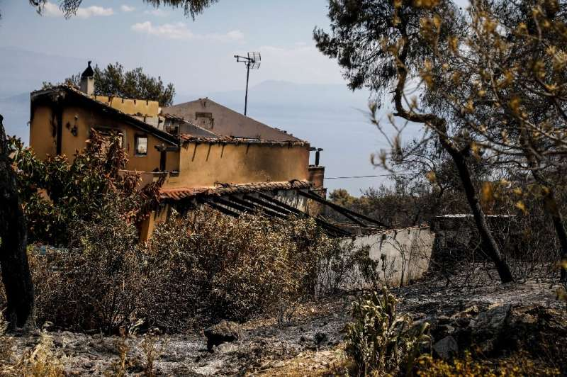 No injuries were reported but a number of houses were damaged, such as this one at Mavrolimni, west of Athens