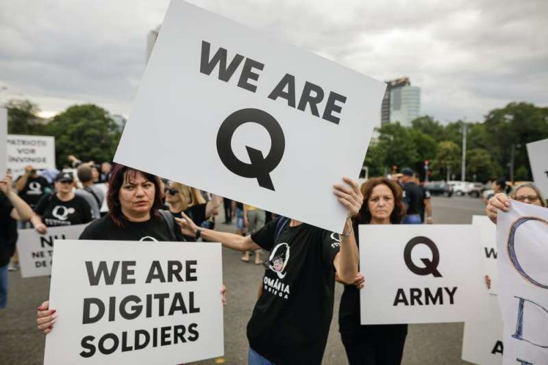 Not two different worlds: QAnon and the offline dangers of online speech