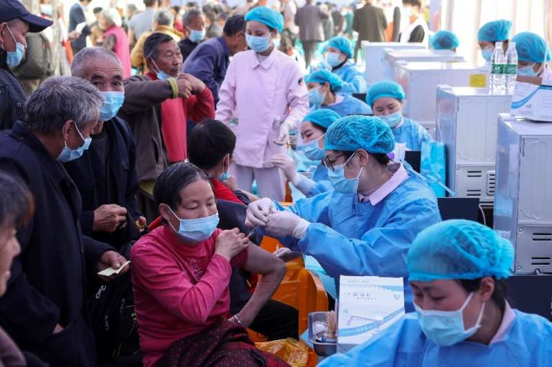 People receive Covid-19 vaccines in China's southwestern city of Chongqing