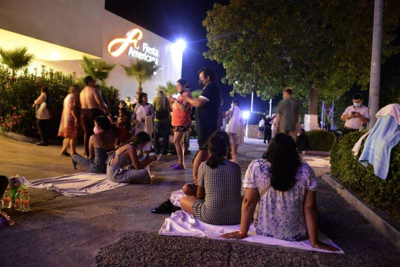 People wait outside a hotel in the Mexican city of Acapulco after a 7.1-magnitude earthquake