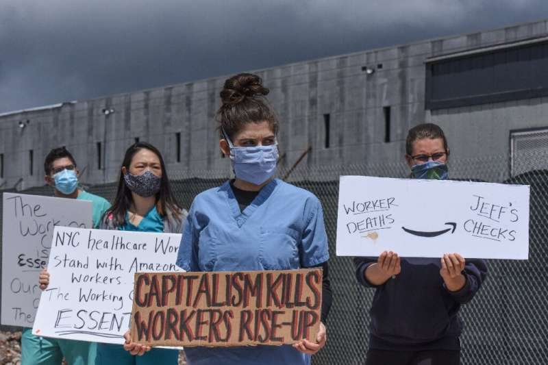 People protest working conditions outside of an Amazon warehouse fulfillment center on May 1, 2020 in the Staten Island borough