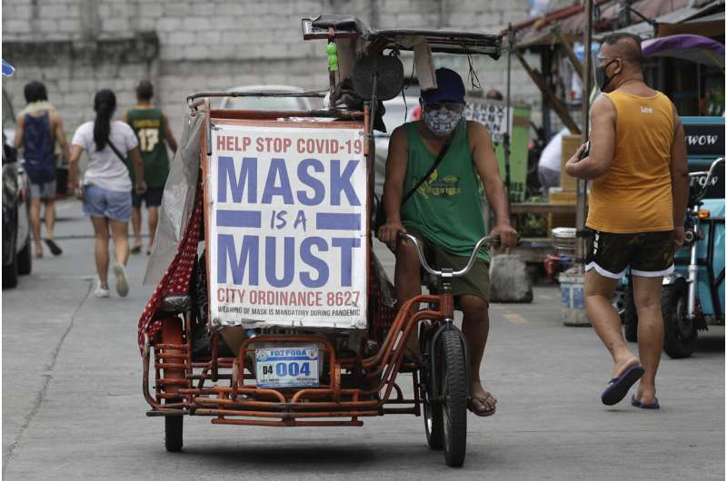 Philippines weighs extending lockdown as COVID cases top 1M