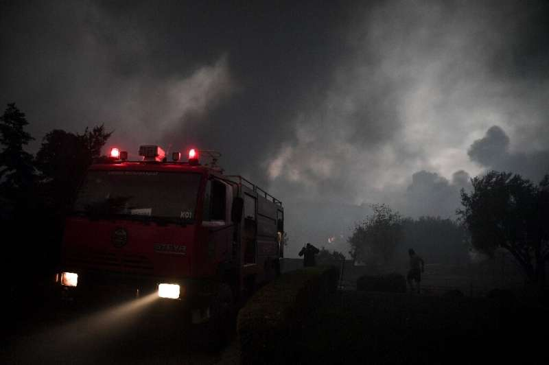 Police and firefighters have evacuated hundreds of people from suburbs north of Athens