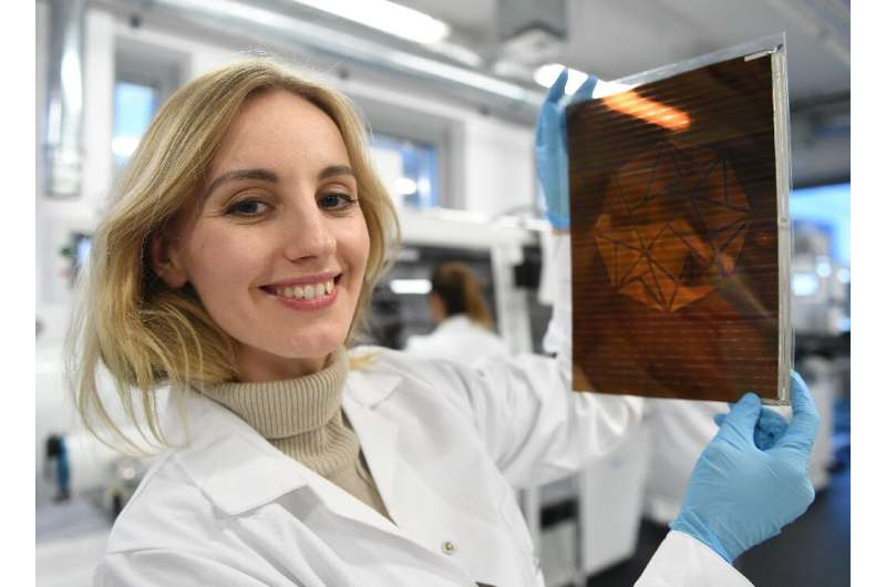 Polish physicist and businesswoman Olga Malinkiewicz with one of the printed solar panels she has developed