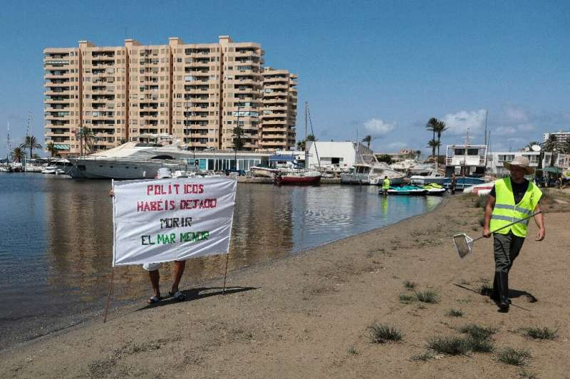 'Politicians you let the Mar Menor die' proclaims a banner on the beach