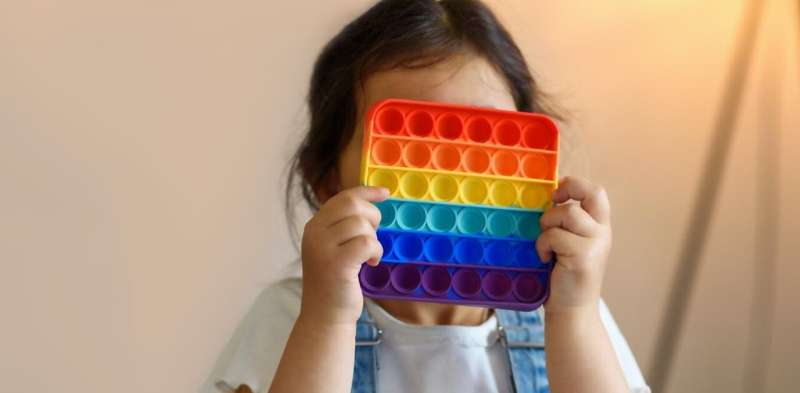 Popping toys, the latest fidget craze, might reduce stress for adults and children alike