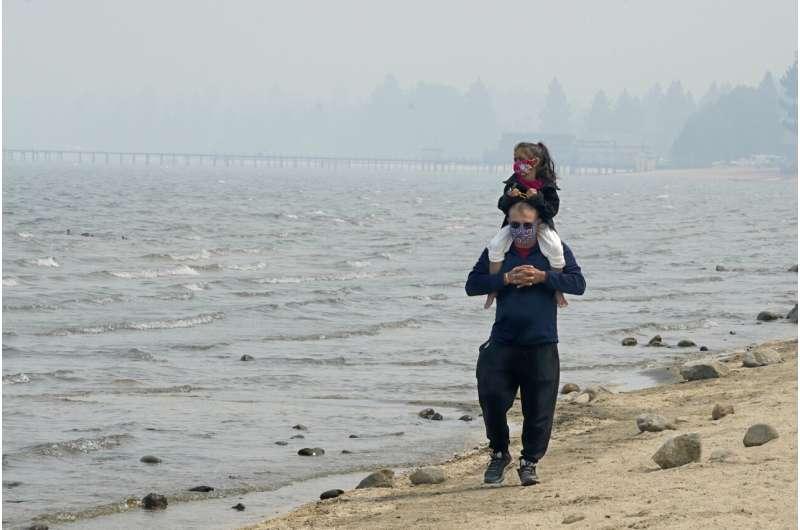 Pristine Lake Tahoe shrouded in smoke from threatening fire