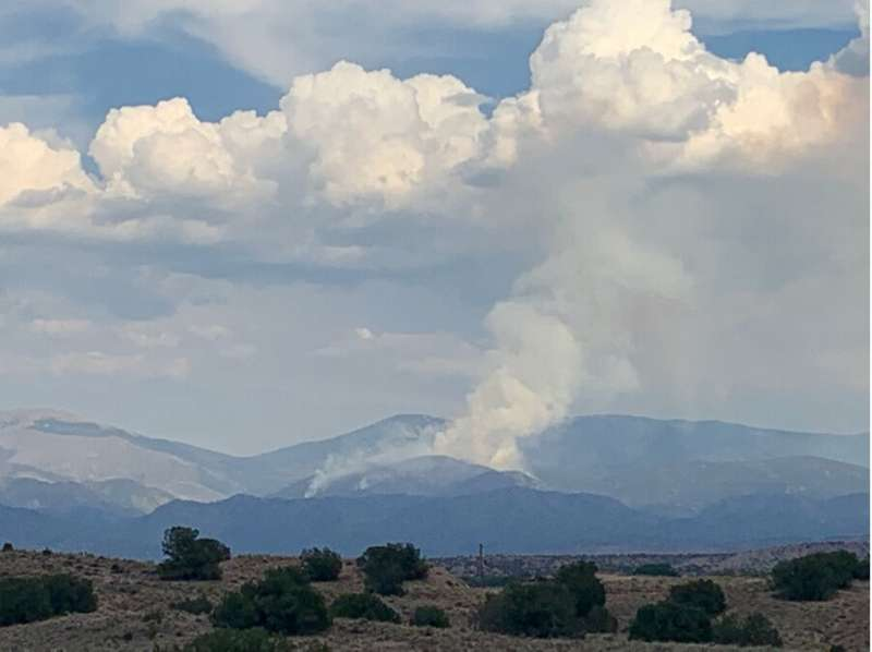 Probing wet fire smoke in clouds: can water intensify the earth's warming?