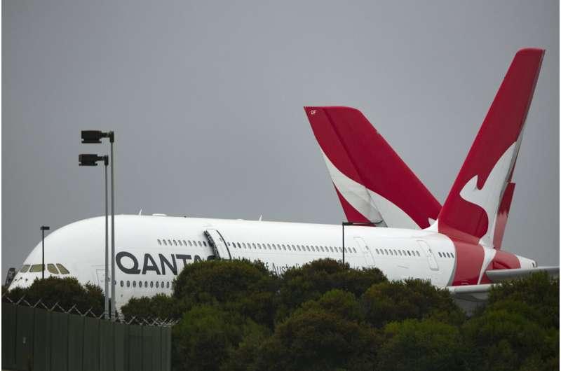 Qantas posts $1.7 billion loss and tips travel by Christmas