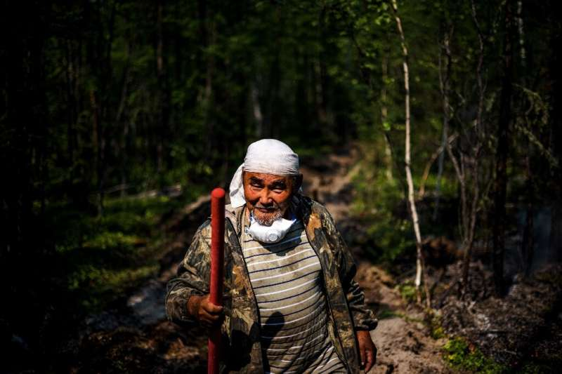 """""""I've lived my whole life in the taiga. I'm dependent on nature,"""" 65-year-old Ivan Fyodorov says as he helps fight a f"""
