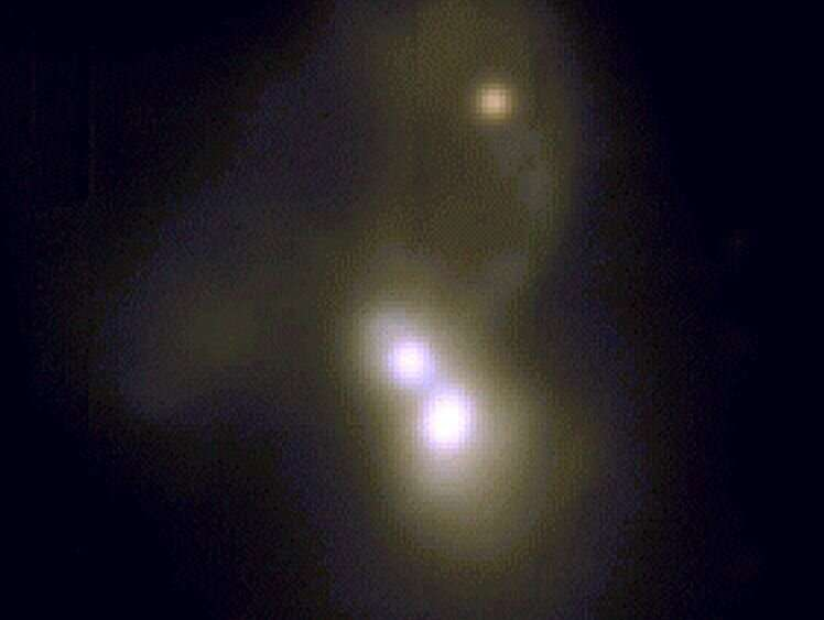 Rare triple galaxy merger with at least two supermassive black holes Rare-triple-galaxy-mer