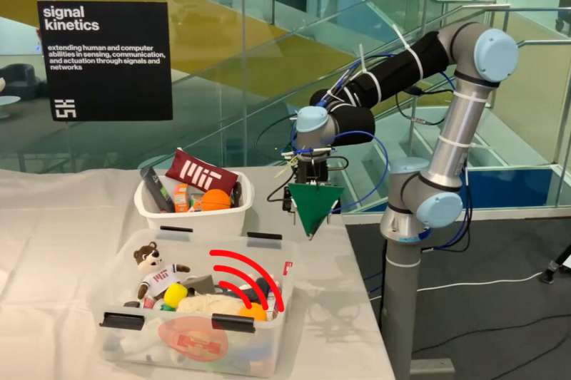 Robotic arm fuses data from a camera and antenna to locate and retrieve items