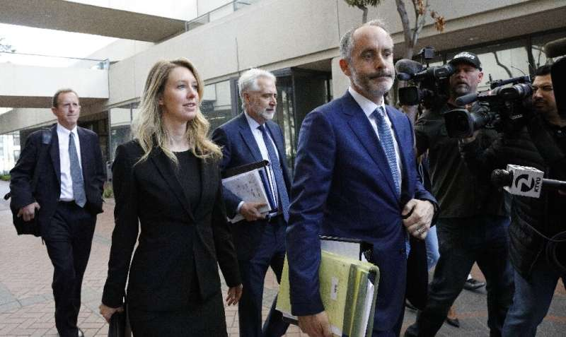 Seen at a 2019 court appearance, former Theranos CEO Elizabeth Holmes became a billionaire from her startup before its  breakthr