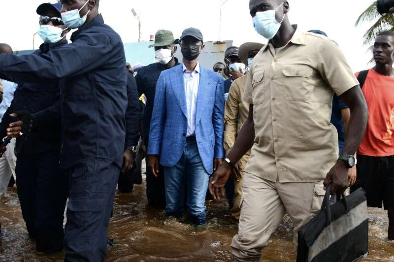 Senegal's Interior Minister, Antoine Felix Abdoulaye Diome, visits flooded areas after heavy rain in Dakar