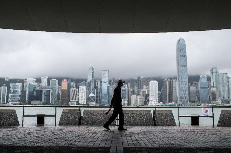 Shares in China's big three state-owned telecom companies slid in Hong Kong after the New York Stock Exchange announced their de