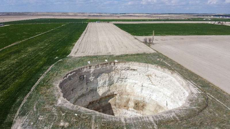 Sinkholes open up when underground caverns created by drought can no longer contain the weight of the layer of soil above