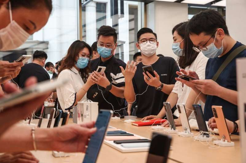 Smartphone maker Huawei began stockpiling semiconductors before Washington sanctioned it last year