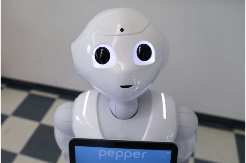 Social robots may be more persuasive if they project less authority