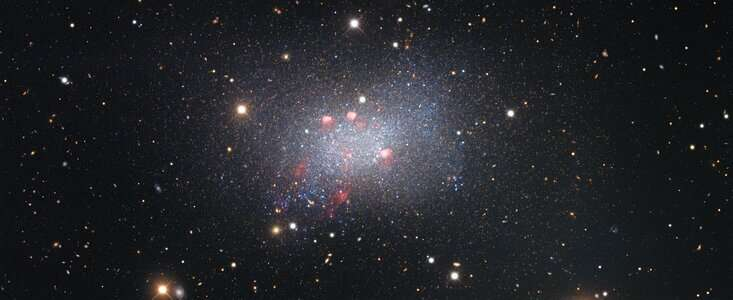 Star-studded image of the Sextans B dwarf galaxy showcases astronomical curiosities near and far
