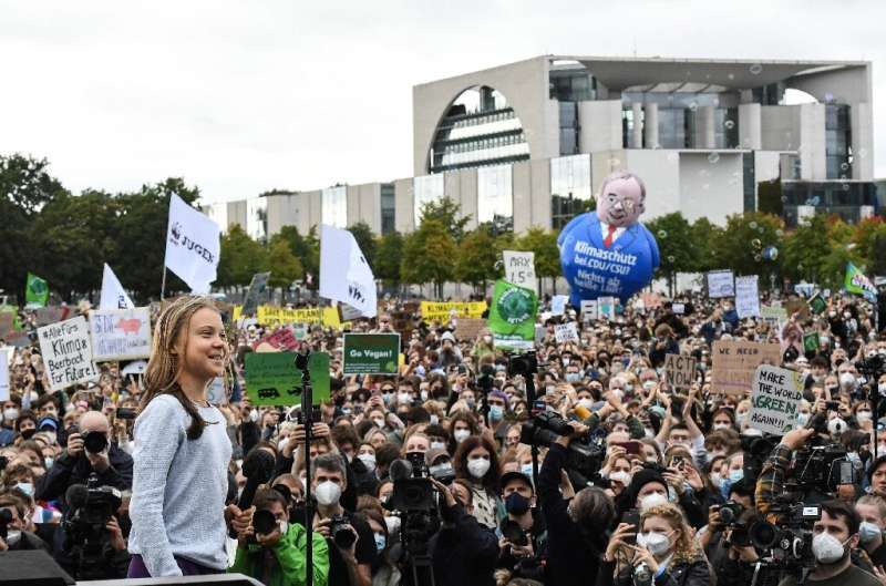 Swedish climate activist Greta Thunberg speaks to demonstrators taking part in a Fridays for Future global climate strike in Ber