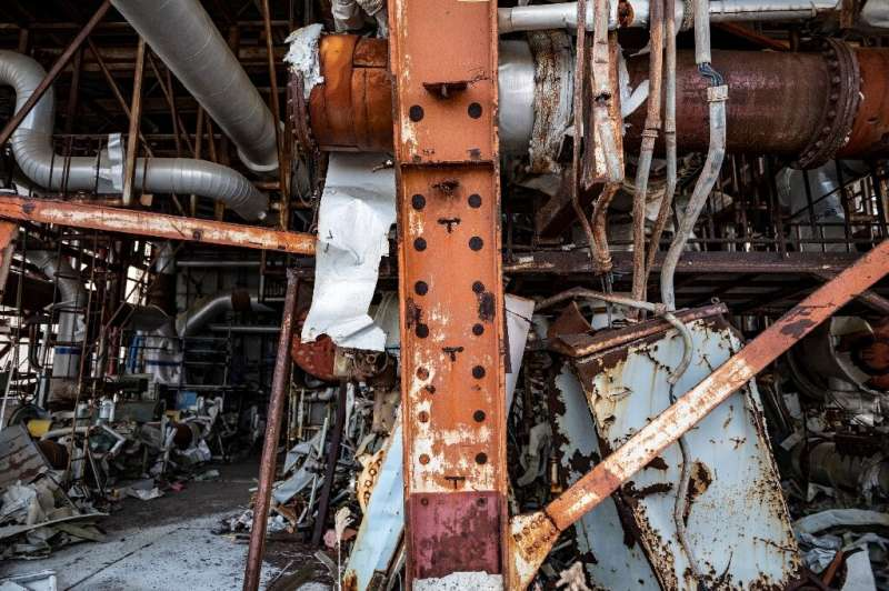 Tangled scrap metal can still be seen strewn around parts of the reactor site