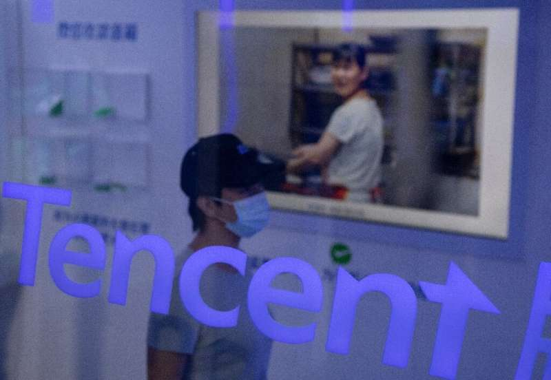 Tencent was found to have failed to declare the acquisition of an auto services firm