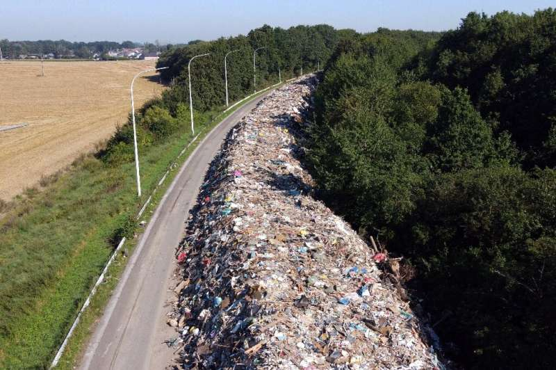 The 90,000 tonnes of domestic debris stretch for eight kilometres (five miles) downthe closed A601 motorway north of the Belgia