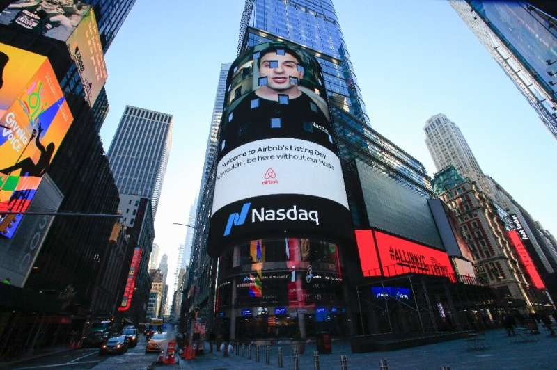The Airbnb logo is displayed on the Nasdaq digital billboard in Times Square in New York on December 10, 2020