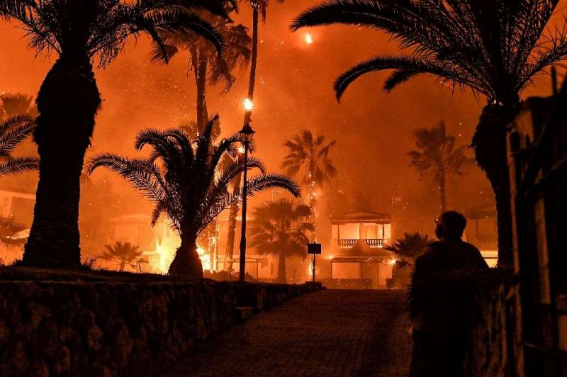 The blaze started late on Wednesday near the village of Schinos
