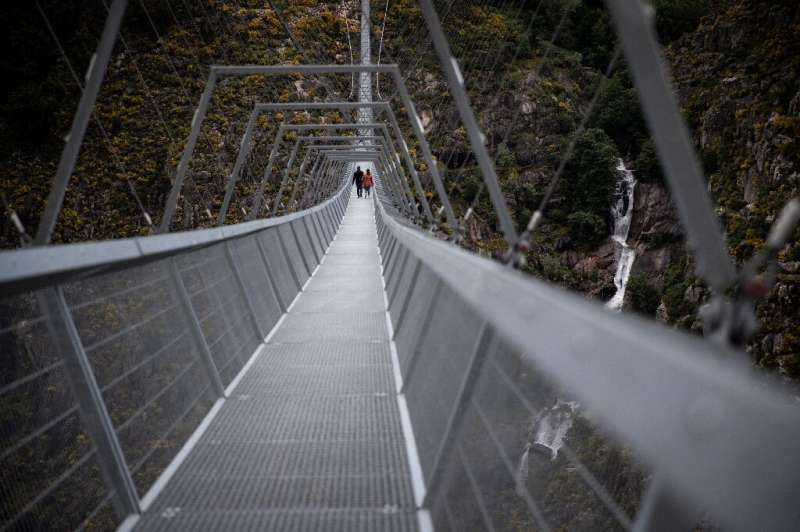 The bridge is named after the local town and the 516-metre length of the suspension