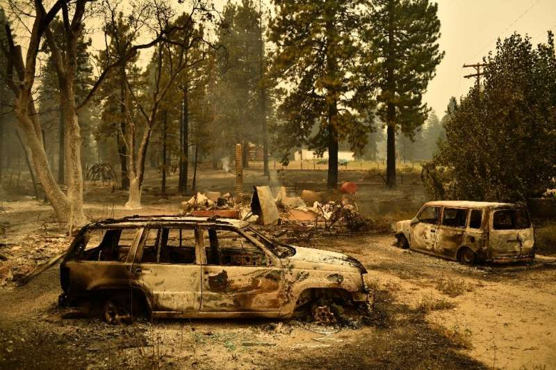 The Dixie Fire has wreaked devastation in Janesville, leaving charred remains of vehicles in its wake