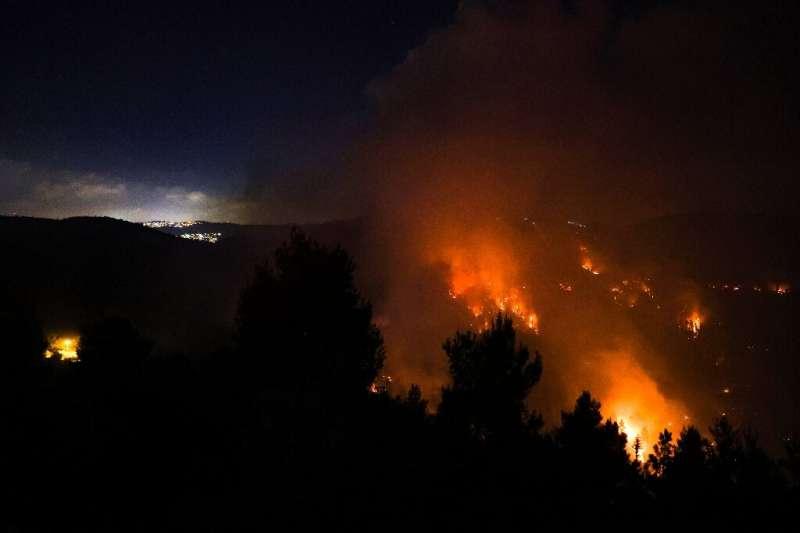 The fire was burning fiercely Sunday evening near the Israeli village of Moshav Shoresh