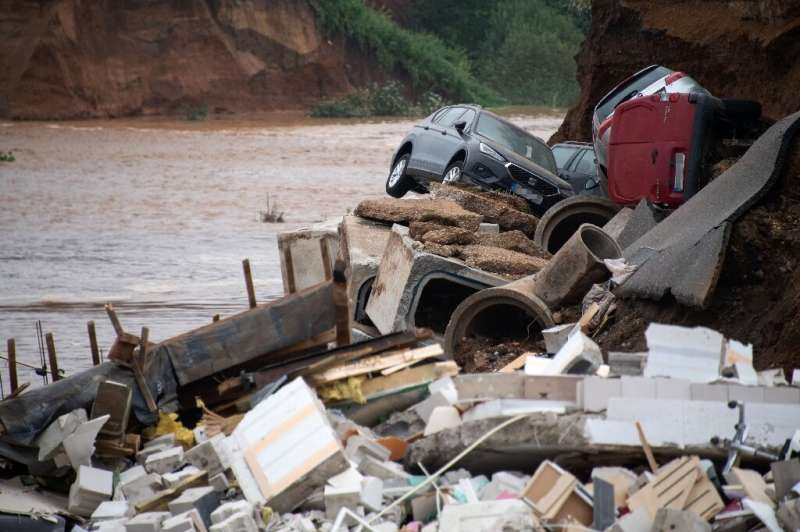 The floods left behind wrecked cars and crumpled buildings