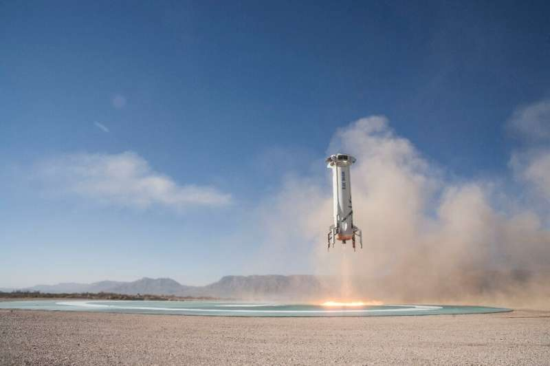 The New Shepard Booster lands in West Texas after a successful Mission 7 in a December 2017 handout photo