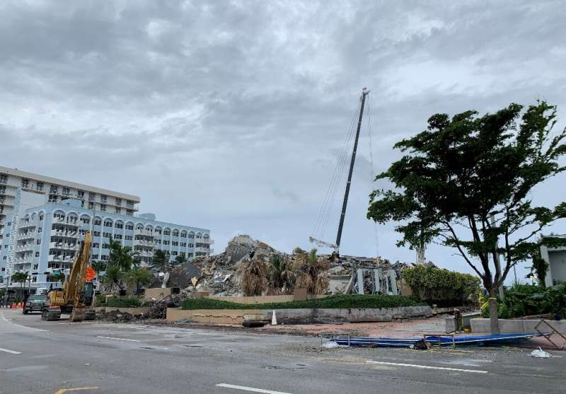The rubble of the Champlain tower in Surfside, Florida on July 6, 2021 as rescuers race to search the collapsed condo before Tro