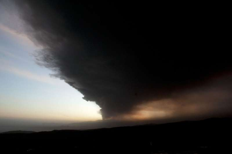 The sun sets in a sky dusted with ash over Màrdalsjškull, 20 km east from Iceland's Eyjafjoell volcano, on May 5, 2010