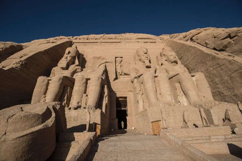 The colossal statues of a seated Ramses II at the entrance of Abu Simbel archaeological site, rescued from the waters of the res