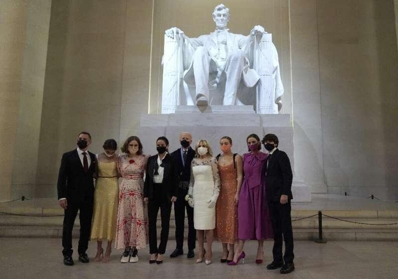 "The new ""first family"" of the United States pose in front of a statue of Abraham Lincoln while wearing face masks foll"