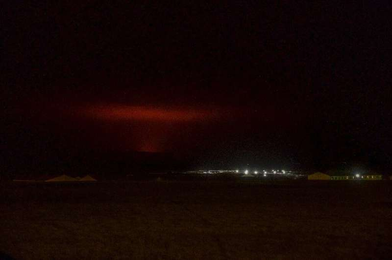 The sky around Iceland's capital turned red after a volcanic eruption on Friday