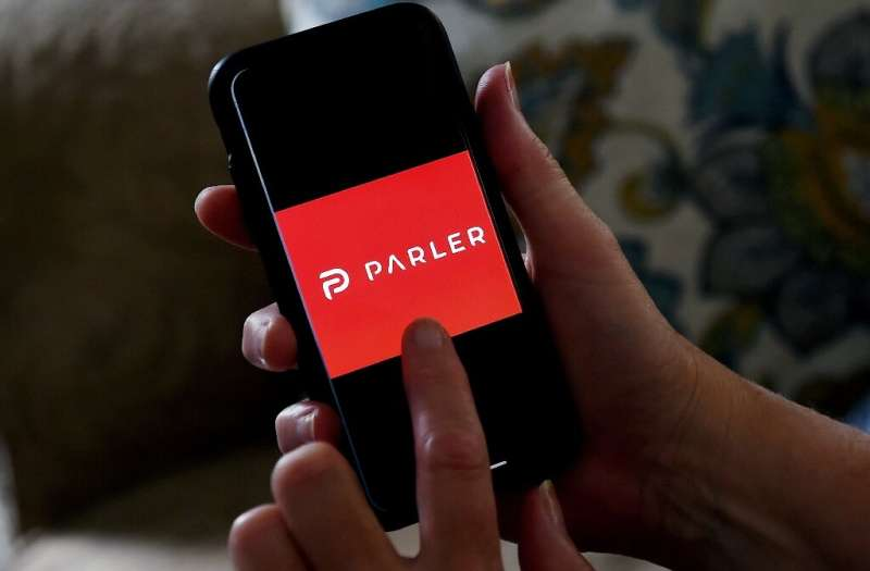 The social network Parler which has been a favorite of conservatives will be allowed back in Apple's online marketplace after ma
