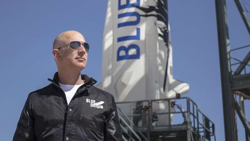 This April 24, 2015 handout photograph obtained courtesy of Blue Origin shows Jeff Bezos at New Shepard's West Texas launch faci