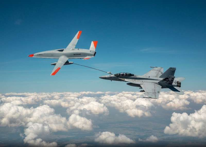 This Boeing handout photo obtained June 7, 2021 shows the Boeing MQ-25 T1 drone as it transfers fuel to a US Navy F/A-18 Super H