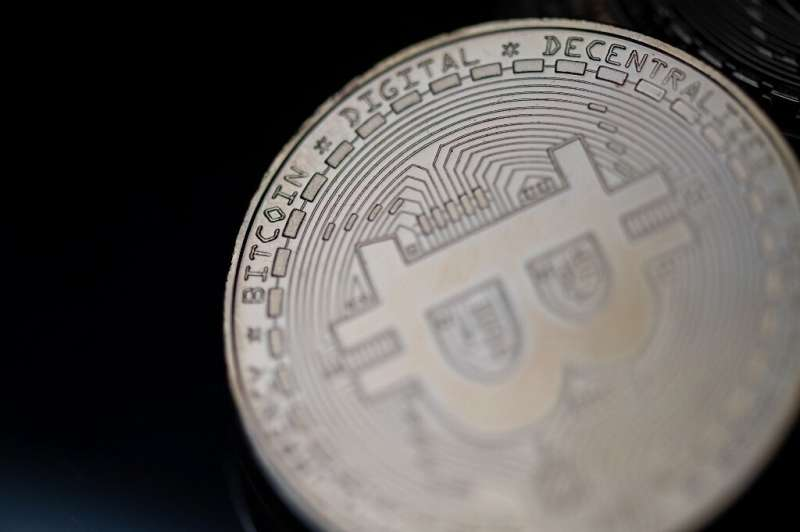 This file photo shows a physical imitation of the bitcoin cryptocurrency