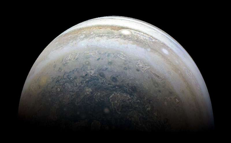 This NASA photo released on July 2, 2018 shows Jupiter's southern hemisphere captured by NASA's Juno spacecraft on the outbound