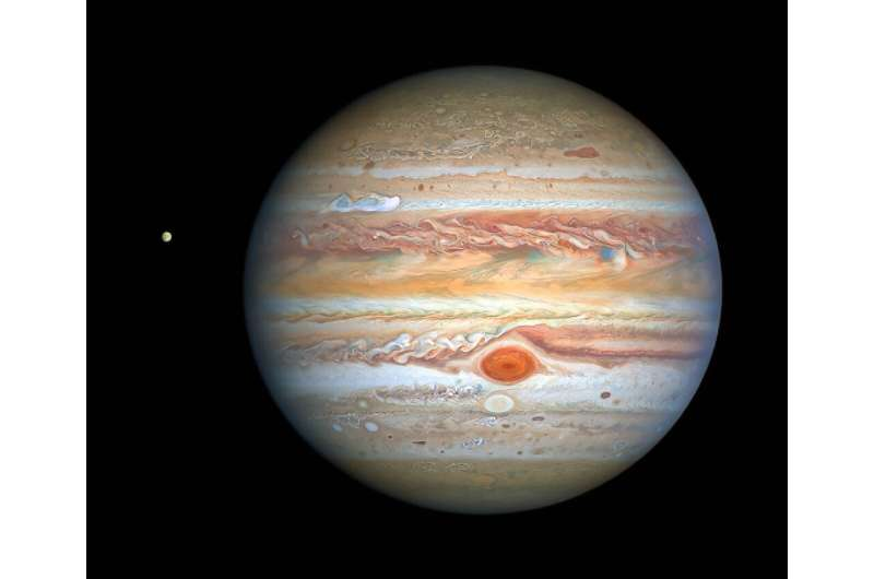 This photograph taken by the Hubble Space Telescope on August 25, 2020 shows Jupiter and its moon Europa, captured when the plan