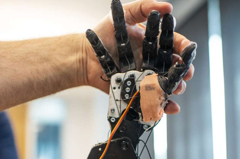 This robot uses tactile sign language to help deaf-blind people communicate independently