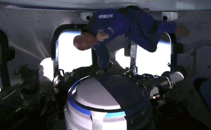 This still image taken from video by Blue Origin shows the space company's founder Jeff Bezos celebrating catching popcorn in hi