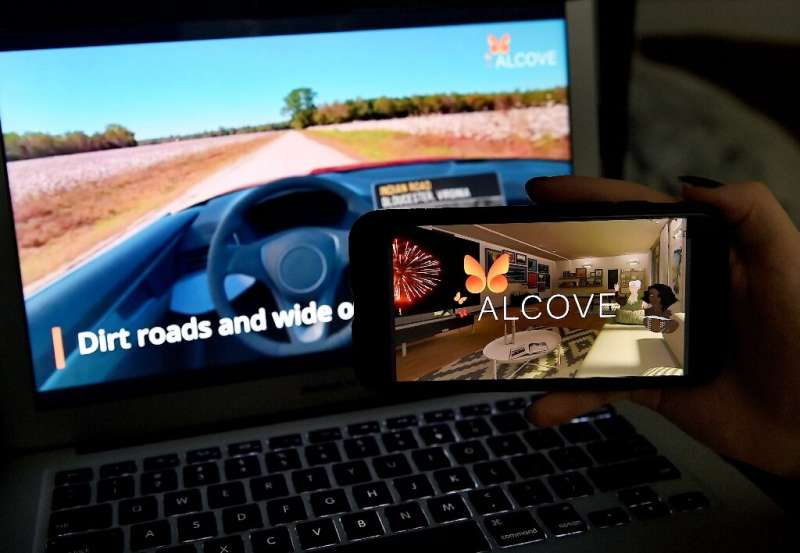 This illustration picture shows a virtual road trip on a computer and the travel application logo from Alcove, a platform for vi