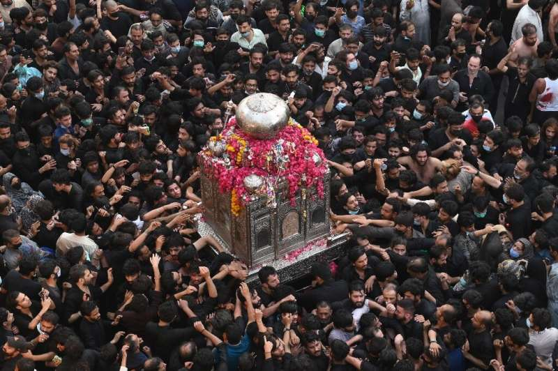 Thousands of Shia Muslims –- many not wearing masks—gathered in the eastern Pakistani city of Lahore for an annual religious pro
